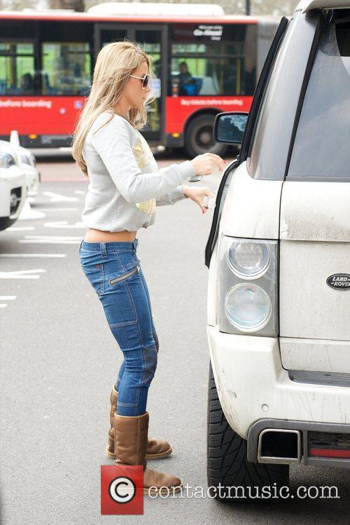 Katie Price and her daughter arriving at their...