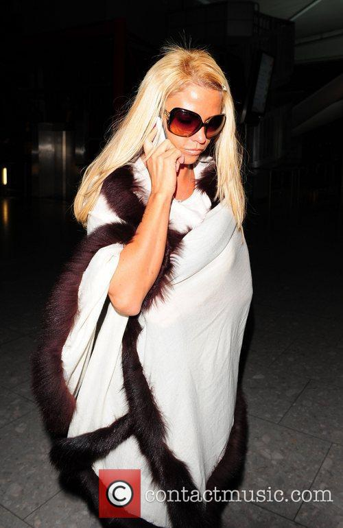 Katie Price arrives at Heathrow Airport to catch...