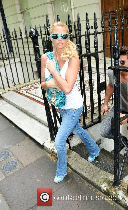 Katie Price and her boyfriend Leandro Penna leave...