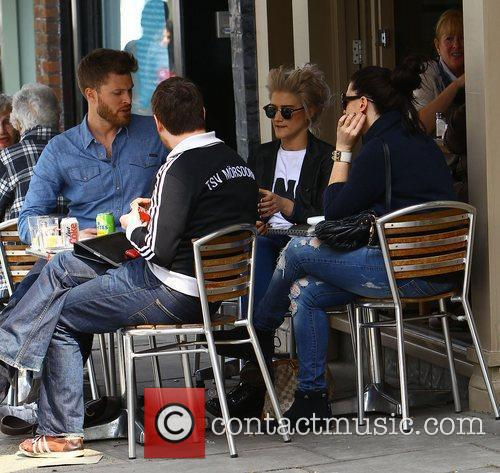 Presenter Rick Edwards and Katie Waissel sitting outside...