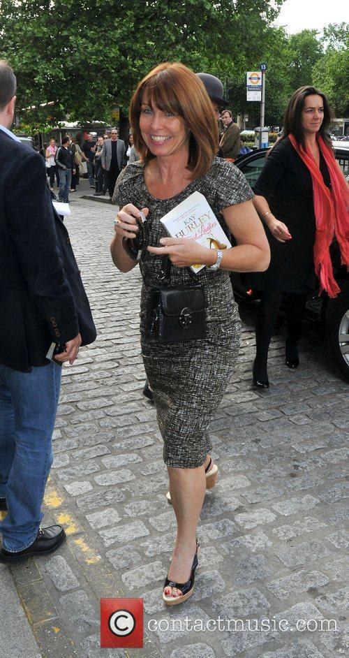 Outside her hotel carrying a copy of her...