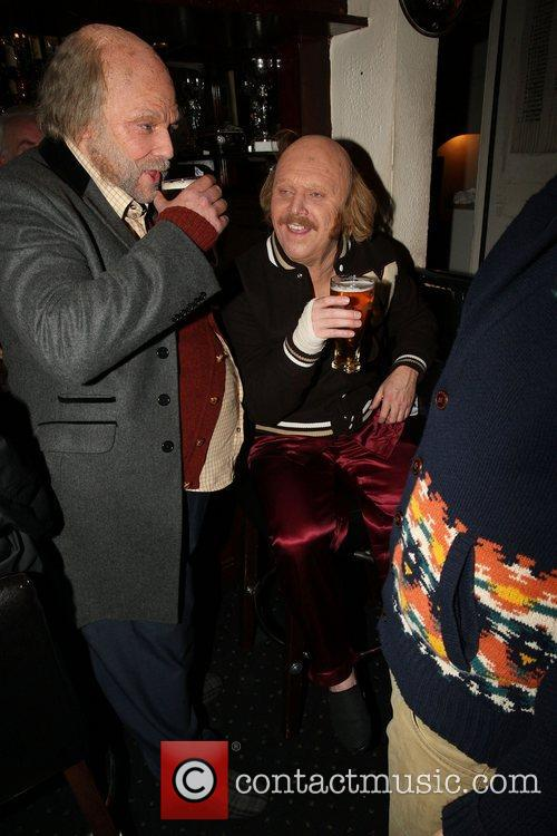 Disguised as two old bald men, enjoying a...