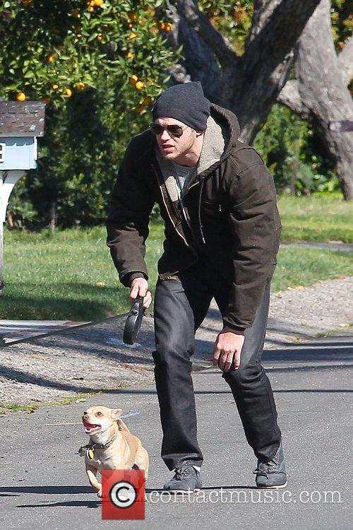 Twilight star, Kellan Lutz, taking his dogs for...