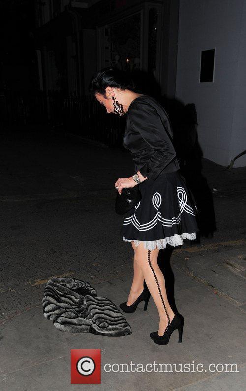 Nancy Dell'Olio drops her jacket celebrities leaving an...