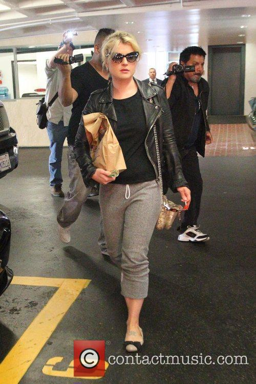 Holding a lolly as she leaves a medical...