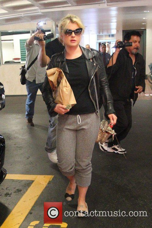 Kelly Osbourne holding a lolly as she leaves...