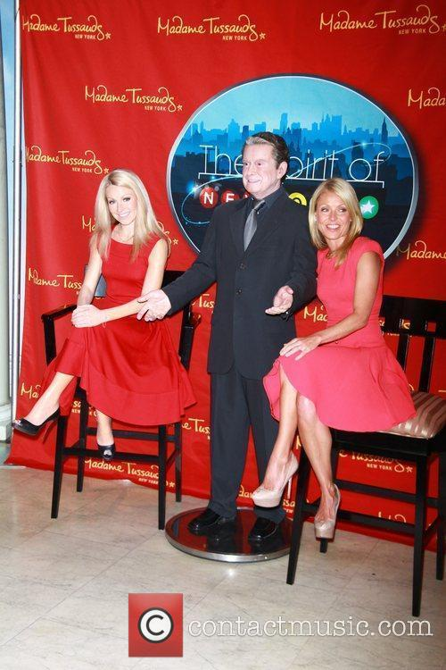 Kelly Ripa poses with both her and Regis...