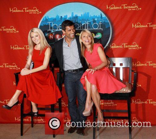 Kelly Ripa alongside husband Mark Consuelos as she...