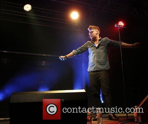 Aiden Grimshaw of 2010 X Factor performing live...