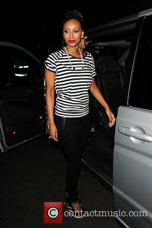 Keri Hilson getting into a vehicle while out...