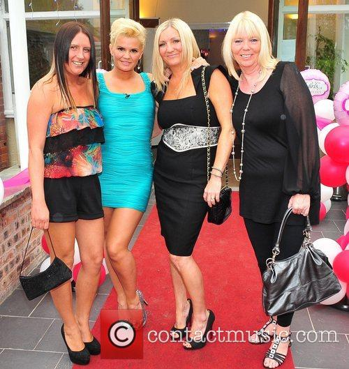 Kerry Katona posing with a group of girlfriends...