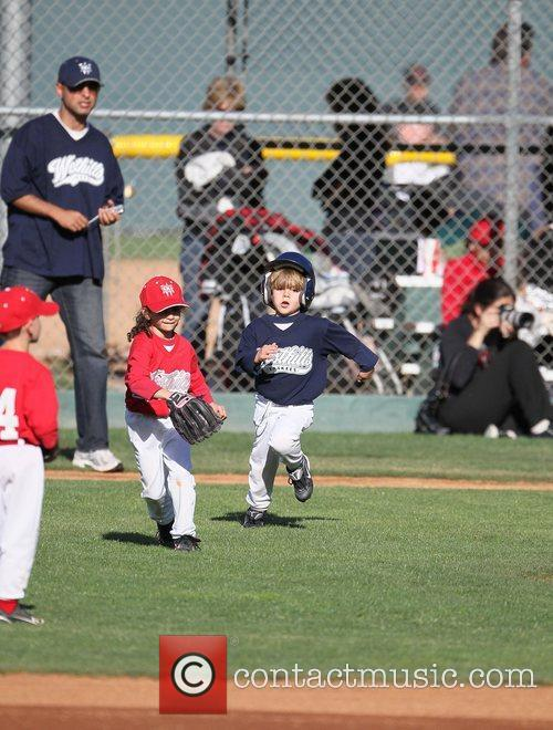 Sean Preston Federline batting and running bases during...