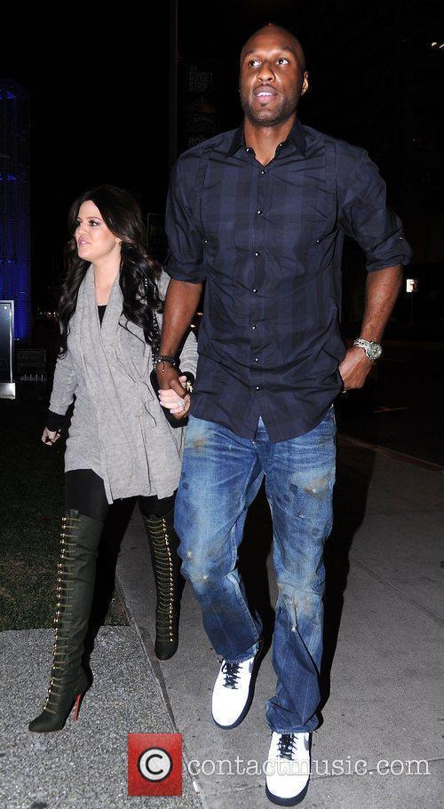 Lamar Odom and Khloe Kardashian hold hands as...