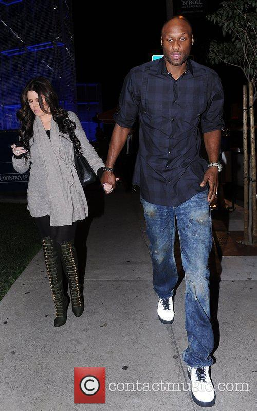 Lamar Odom and Khloe Kardashian hold hands as...