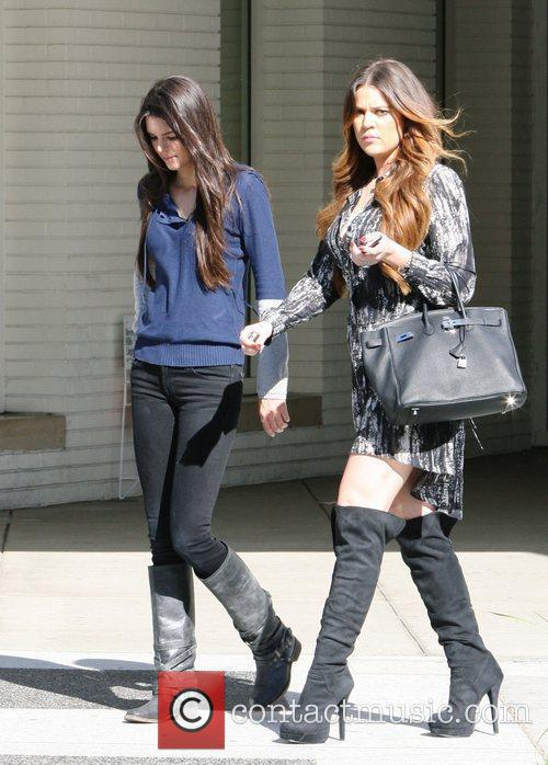 Khloe Kardashian and her sister Kendall Jenner head...