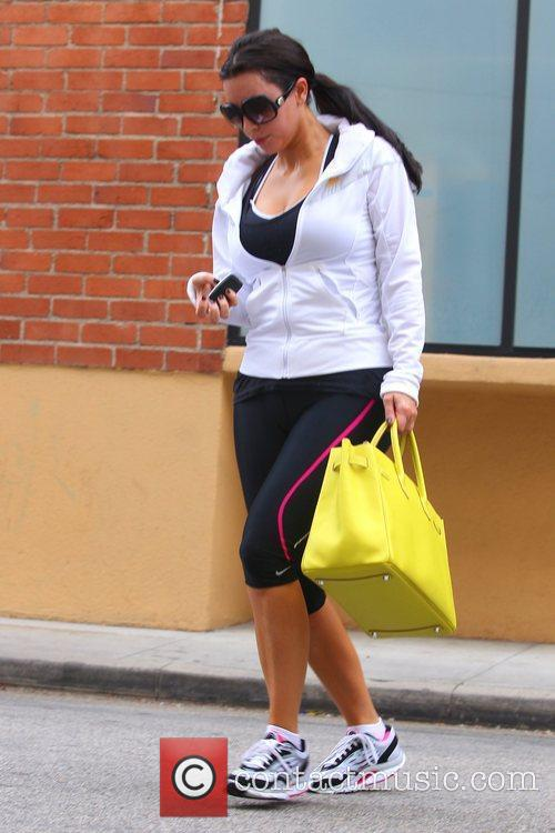 Kim Kardashian is seen leaving the gym in...