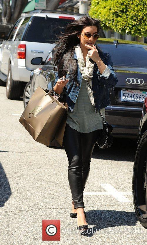 Kim Kardashian leaves a hair salon on a...