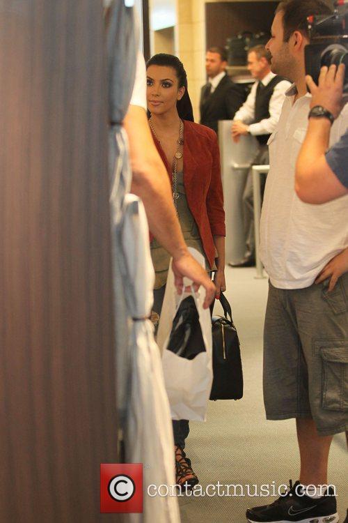 Kim Kardashian is followed by a film crew...