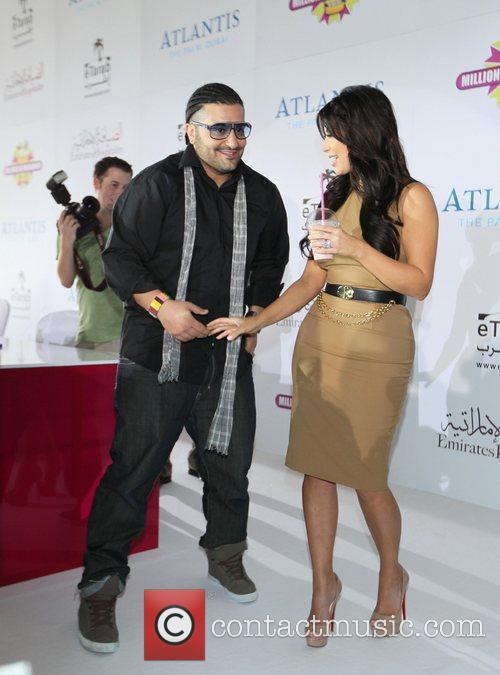 Kim Kardashian meets a fan at the press...