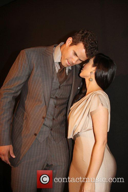 Kim Kardashian and Kris Humphries attending a party...