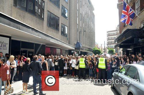 Huge crowds gather outside Debenhams on Oxford Street...