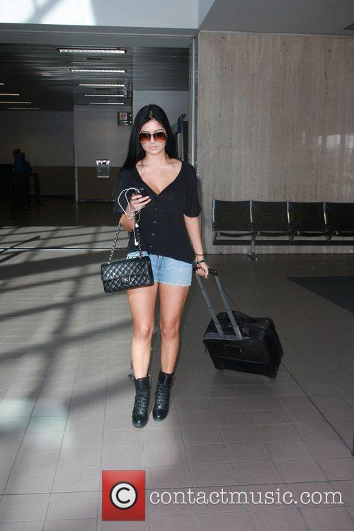 Actress and model, Kim Lee, arrives at LAX...