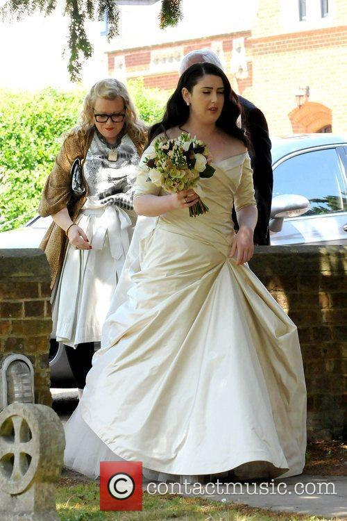 Claire Mitchell arrives at her wedding in Upper...