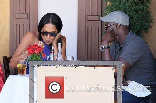 Kimora Lee Simmons and Djimon Hounsou 31