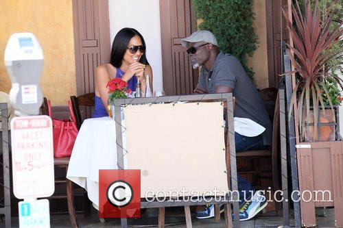 Kimora Lee Simmons and Djimon Hounsou 29
