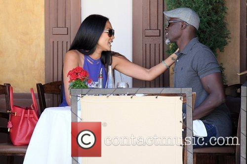 Kimora Lee Simmons and Djimon Hounsou 33