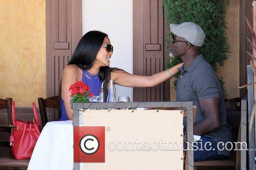 Kimora Lee Simmons and Djimon Hounsou 22