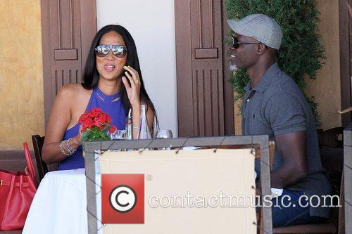 Kimora Lee Simmons and Djimon Hounsou 24