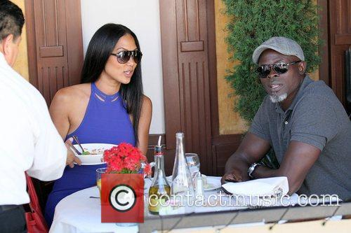 Kimora Lee Simmons and Djimon Hounsou 13