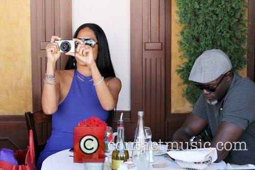 Kimora Lee Simmons and Djimon Hounsou 30