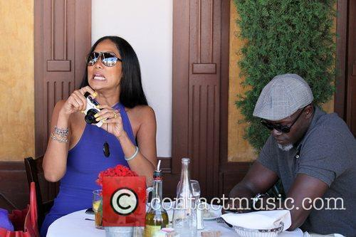 Kimora Lee Simmons and Djimon Hounsou 23