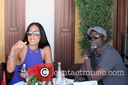 Kimora Lee Simmons and Djimon Hounsou 18