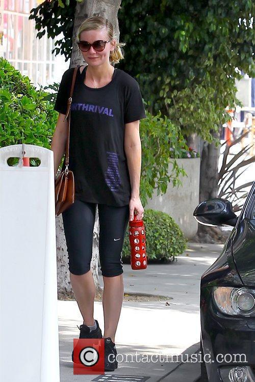 Kirsten Dunst returning to her car after working...