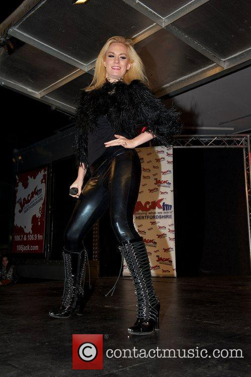 Kitty Brucknell performing during the Christmas lights switch...