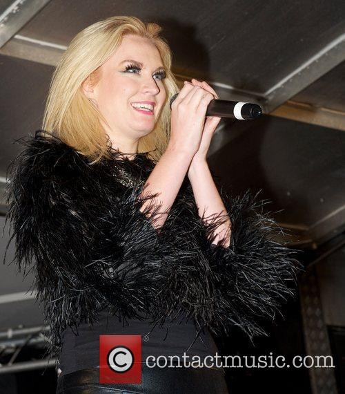 Performing during the Christmas lights switch on at...