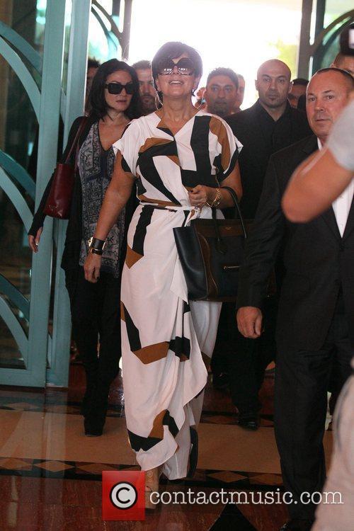 Arrives at the Atlantis Palms hotel in Dubai...