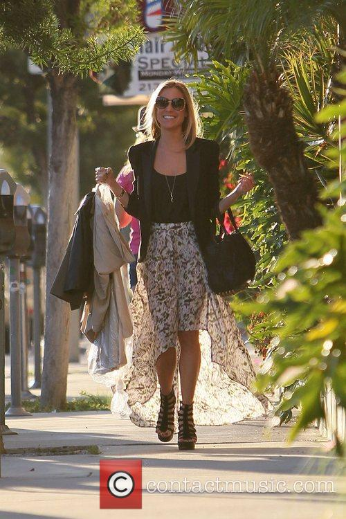 Departs a tailor's shop on Melrose Avenue while...