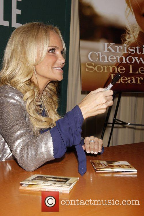 Signs copies of her new album 'Some Lessons...