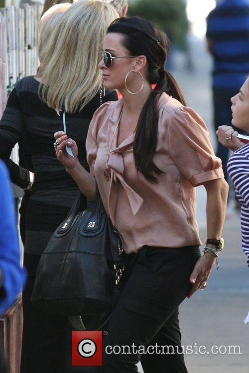 Kyle Richards heads into The Ivy on Robertson...