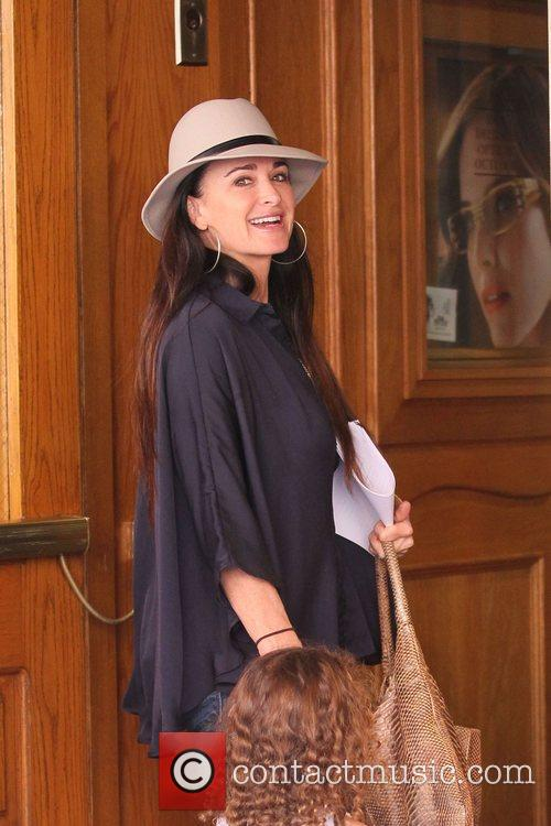 Kyle Richards and her daughters head into a...