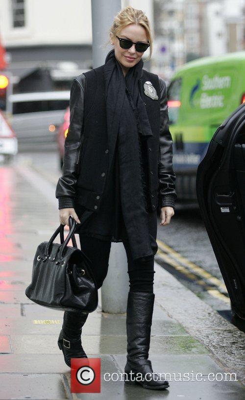 Dressed all in black leaving her house