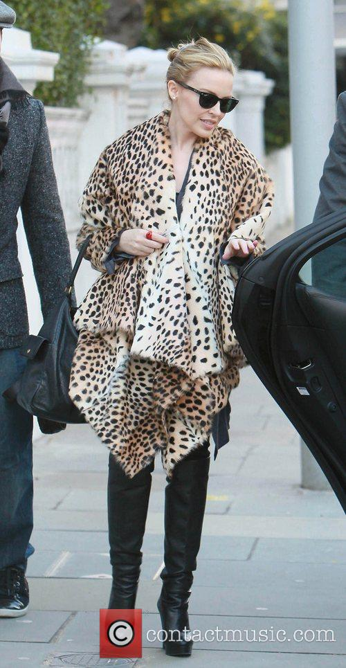 Leaving her home wearing an animal print coat