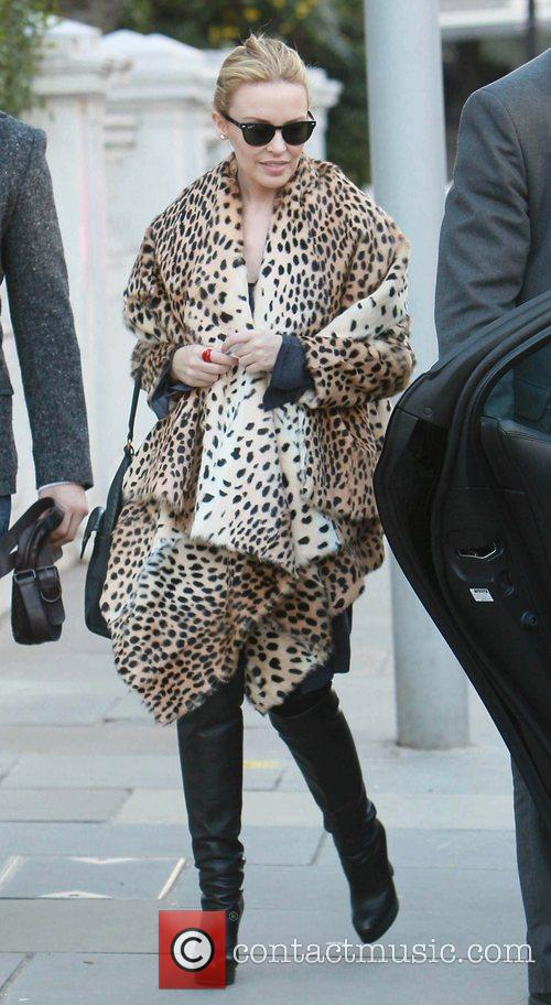 Kylie Minogue leaving her home wearing an animal...