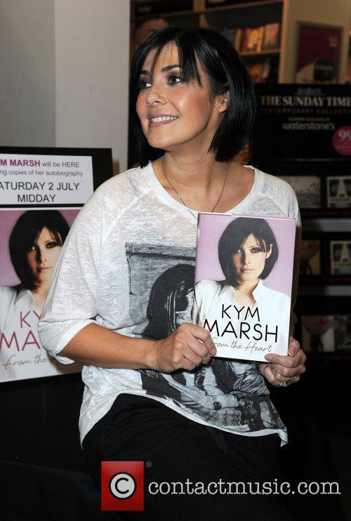 Kym Marsh signs copies of her new book...
