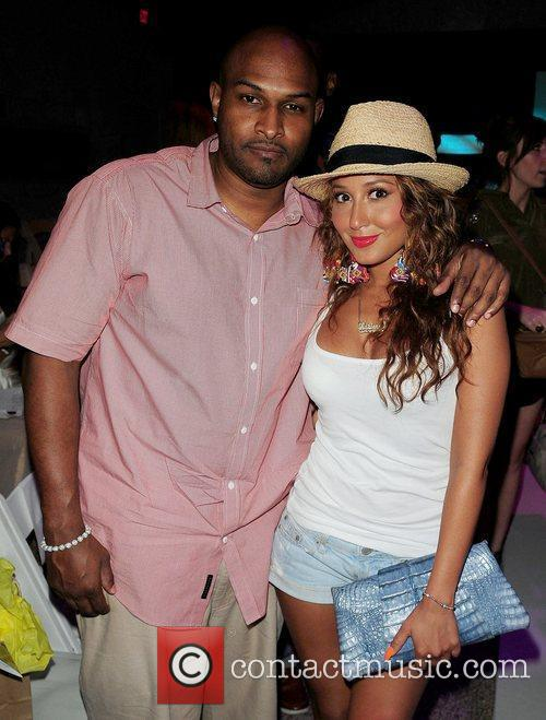 Michael Gardner, Adrienne Bailon attend the L*SPACE BY...