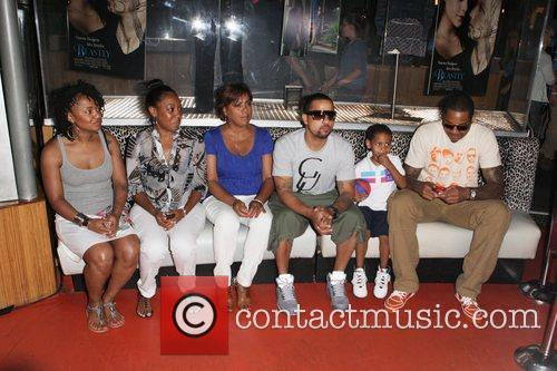 LaLa Vazquez's family along with her husband Carmelo...